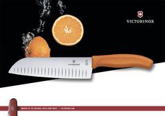 Нож Victorinox сантоку 17 см рифленое, оранжевый, в картонном блистере 6.8526.17L9B